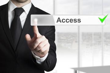 businessman pushing button access