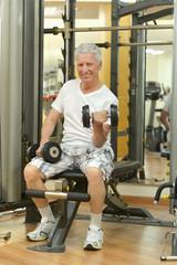 Elderly man in a gym.