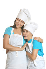 Smiling female chef with assistants