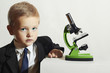 little boy in tie.child with microscope.Schoolboy.Science