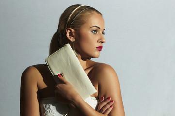 Beautiful blond woman.Fashion girl.Shopping.Bride with clutch