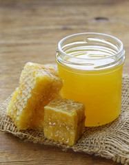natural organic honey in the comb on a wooden background