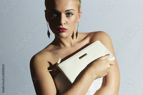 Beautiful blond woman.girl with clutch.White bride dress