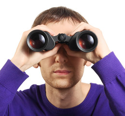 Man looking through binoculars isolated on white