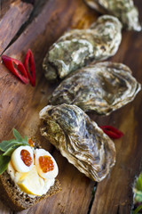 Fine de claire oysters with red caviar and quail eggs