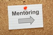 Mentoring this way message on a cork notice board