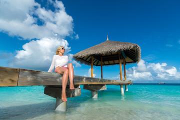 Woman with bronze tan enjoying beach relaxing