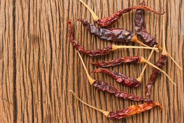 dried chili pepper on wooden table