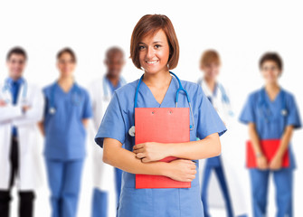 Nurse in front of a group of medical workers