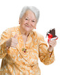 Old happy woman with ice cream showing ok sign
