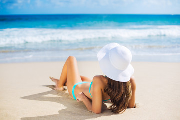 Woman relaxing on the beach