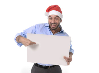 handsome man in santa christmas hat pointing blank billboard