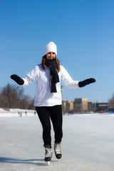 Healthy young woman ice skating during winter