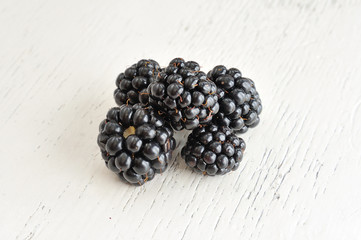 Blackberries on White Wooden Background