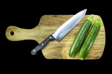 Chopping board with two courgettes