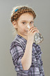 little girl is drinking water