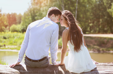 Young sensual couple in love outdoors