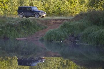 Jeep wrangler in the forest ,Novgorod region, Russia