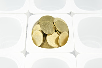 Gold coin in cup