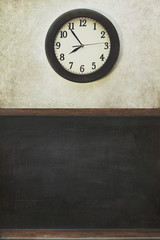 Clock and blackboard with distressed wall