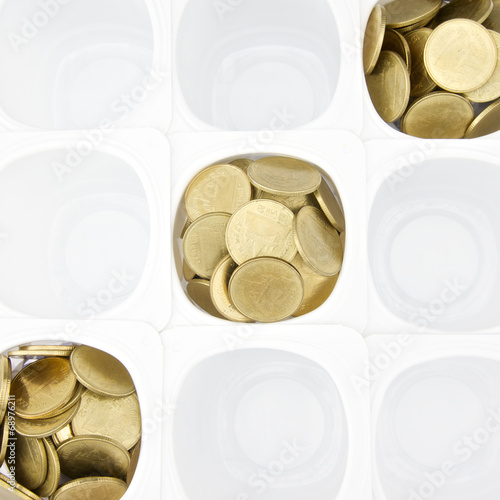 Gold coin in white cup