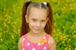 little girl in green summer city park