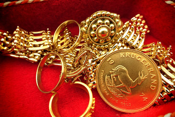 Jewelry box with gold jewelry nd Krügerrand coin