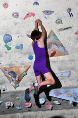 Child exercising at bouldering gym