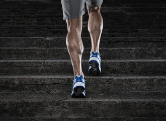 Close up of young man running up the stairs