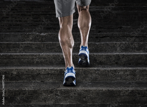 Close up of young man running up the stairs - 68977406