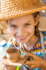 Little girl with pot