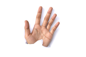 Image of human hand reaching out through torn paper