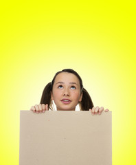 Trendy young girl holding to a blank card