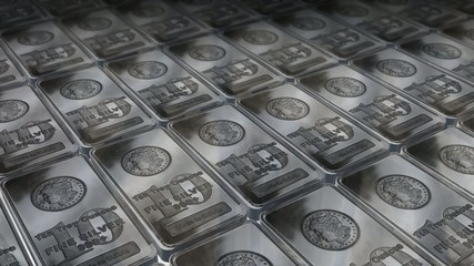 Dolly shot across 10 ounces silver bars