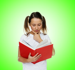 Smart cute girl reading from a red book