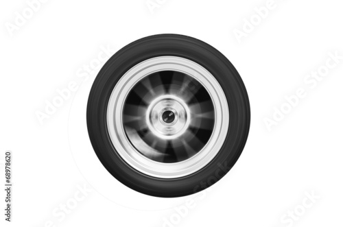The wheel spinning isolated on white background - 68978620