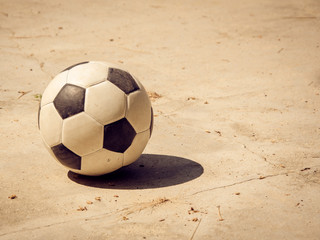 soccer football on cement floor