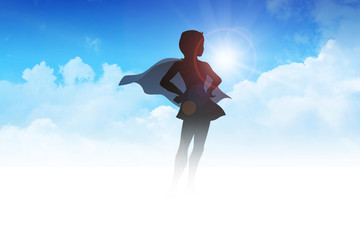 Silhouette of a superheroine on clouds