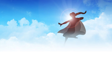 Silhouette of a superheroine flying on clouds