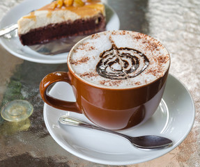 Cup of coffee and cake in cafe