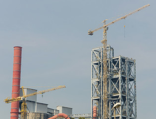 Industrial zone, Steel pipelines and crane in factory