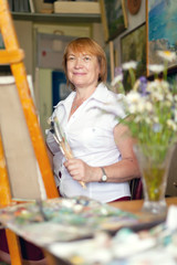 Female artist painting a picture