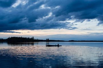 Sunset kayaking at lake