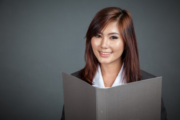Happy Asian businesswoman with a folder