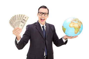 Wealthy businessman holding money and a globe