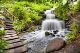 Fototapeta Cascade waterfall in Planten un Blomen park in Hamburg