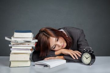Asian businesswoman get tired reading many books