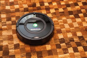 Robotic vacuum cleaner on carpet