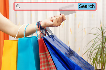 Girl showing shopping bags with search bar. Concept of on line s