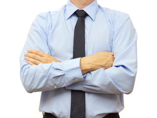 Businessman with blue shirt and tie with crossed hands